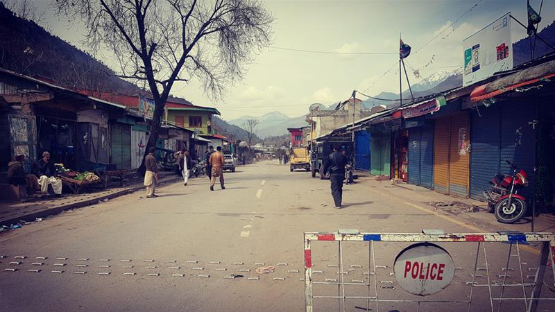 Only men remain in this village on the Pakistani side of Line of Control in Kashmir [Imran Khan/Al Jazeera]