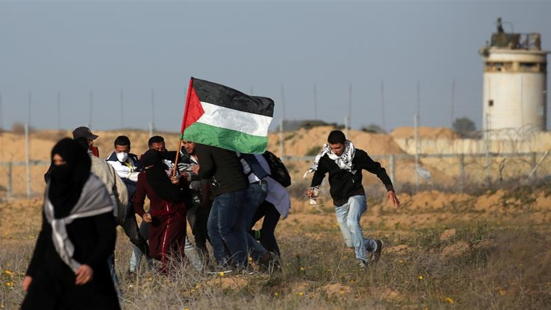 A wounded Palestinian is evacuated during a protest near the Israeli fence east of the southern Gaza Strip [File: Ibraheem Abu Mustafa/Reuters]