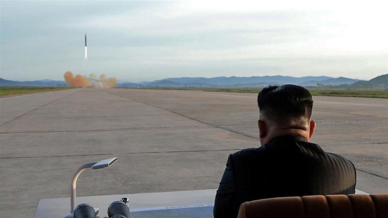 Kim Jong Un watches the launch of a Hwasong-12 missile in an undated photo that was released in September 2017 [Reuters]