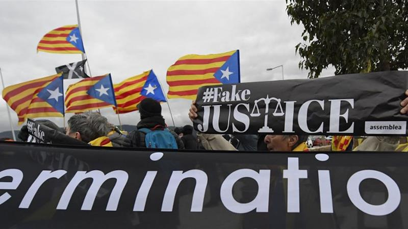 The assessment called for the release of the three separatists [File: Lluis Gene/AFP]