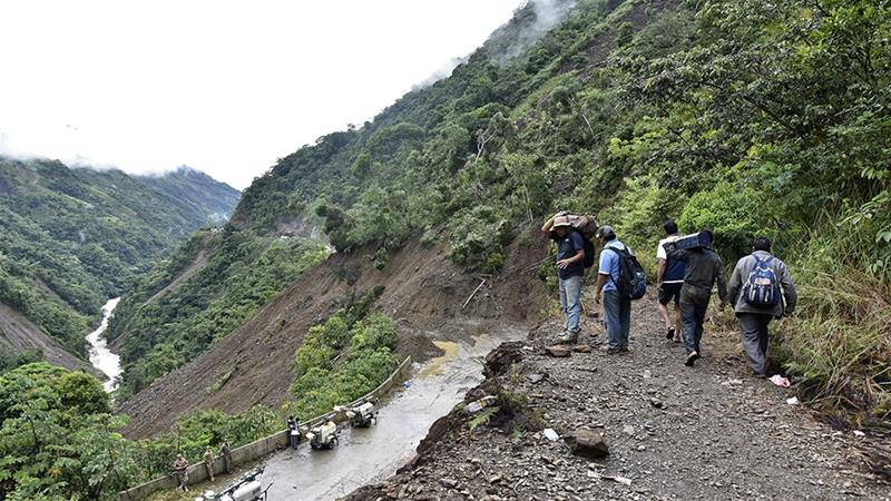 At least 14 people killed in Bolivia landslides