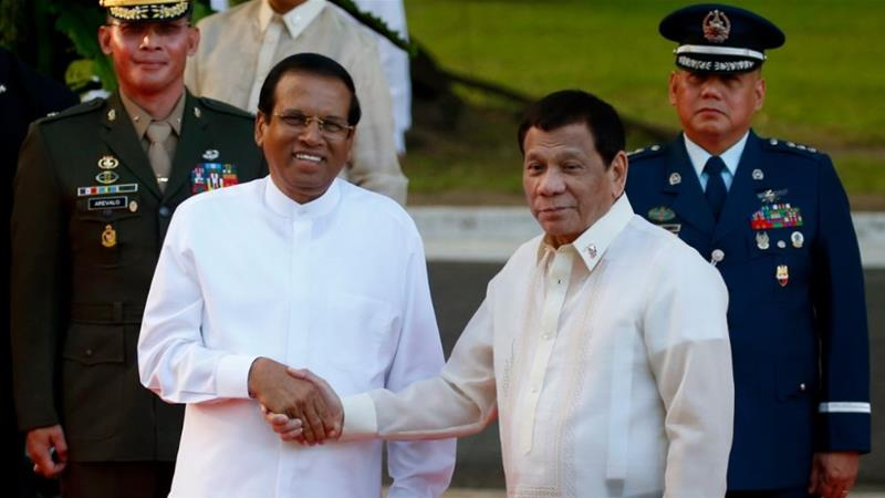In a visit to the Philippines last month, Maithripala Sirisena (L) said he wanted to replicate Rodrigo Duterte's approach to tackling illegal drug use [Bullit Marquez/The Associated Press]