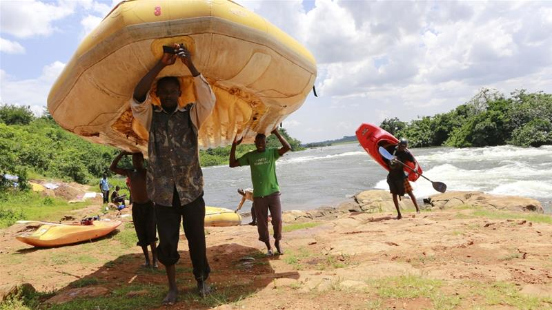 Men carry rafts and kayaks used during white water rafting at Itanda falls on the River Nile near Jinja district, 109km east of the Ugandan capital of Kampala [ File: James Akena/Reuters]