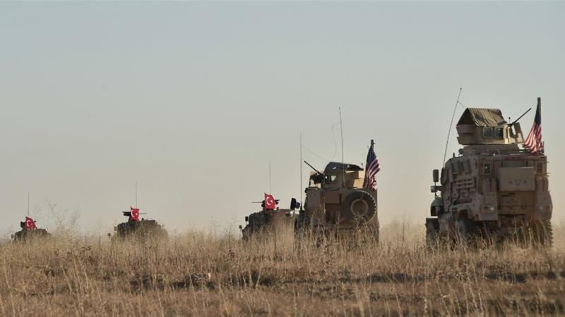 Turkish and US troops conduct joint patrols around the Syrian town of Manbij [File: Turkish defence ministry via AP]