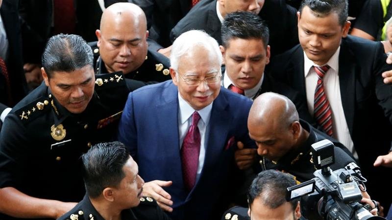 Najib Razak arrives to be formally charged in a Kuala Lumpur court in July; the first of a series of trials related to failed state fund 1MDB starts on Tuesday [Lai Seng Sin/Reuters]