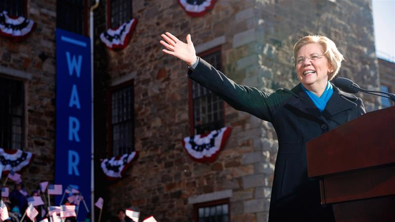 Senator Warren waves at the crowd at the campaign rally in Lawrence, Massachusetts [Brian Snyder/Reuters]