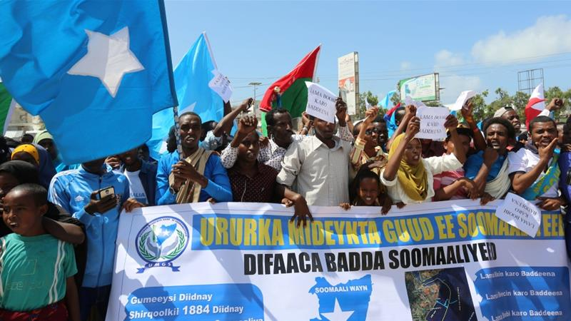 File: Somali people demonstrate against Kenya's claims over a disputed sea-shelf area containing deposits of oil and gas, in Mogadishu, Somalia Sep 21, 2016 [File: Feisal Omar/Reuters]