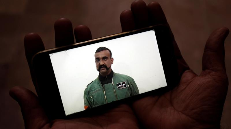 A man watches a statement of Indian Air Force pilot Abhinandan Varthaman on his mobile phone