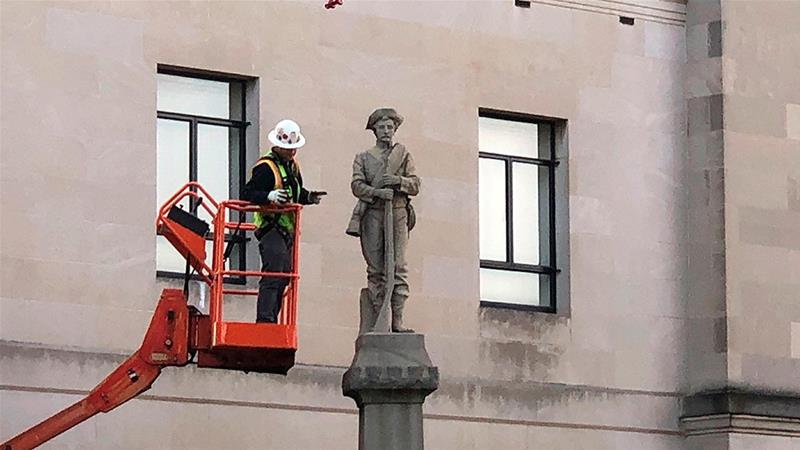 A workman prepares a Confederate statue for removal on Tuesday, March 12, 2019, in Winston-Salem, NC. [Tom Foreman Jr/AP Photo]