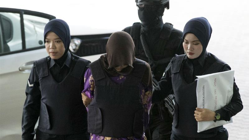Vietnamese national Doan Thi Huong is escorted by Malaysian police as she leaves court last June [Vincent Thian/AP]
