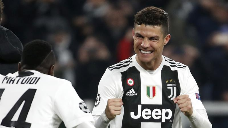 Ronaldo celebrates with teammate Matuidi at the end of the Champions League round of 16 in Turin [Antonio Calanni/AP]