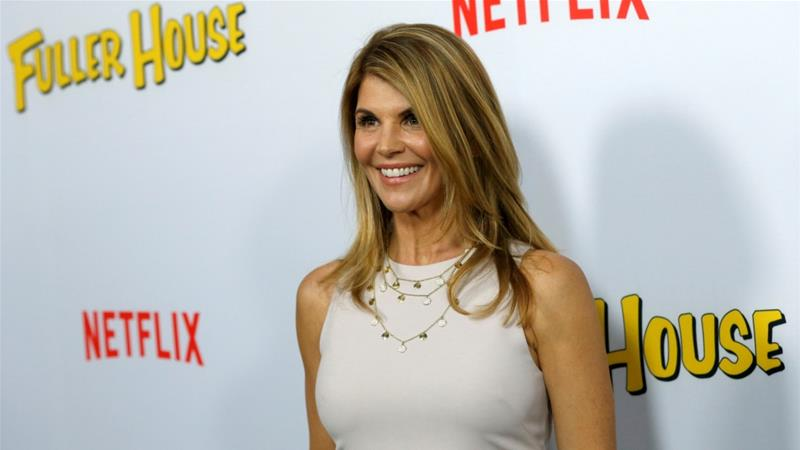 Lori Loughlin poses at the premiere for the television series Fuller House at The Grove in Los Angeles, California [File: Mario Anzuoni/Reuters]