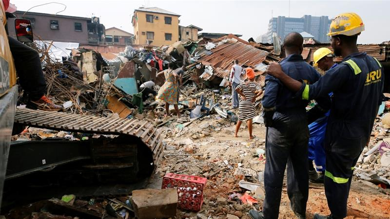 Nigerian officials say the collapsed building was marked for demolition in 2017 [Afolabi Sotunde/Reuters]