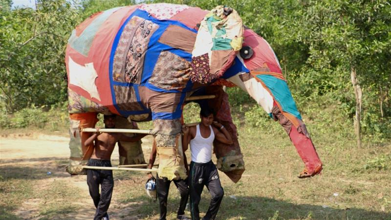 Building an elephant puppet involved the whole community, from the bamboo structure to the fabric made from used clothes and rags [Susannah Savage/Al Jazeera]