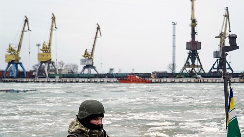 A Ukrainian serviceman stands on board a coastguard ship in the Sea of Azov port of Mariupol, eastern Ukraine [File: Evgeniy Maloletka/AP]