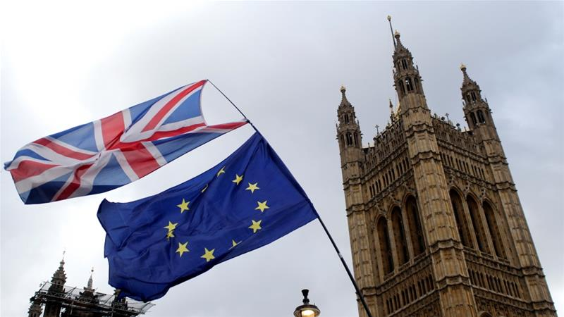 Flags flutter outside the Houses of Parliament on March 13, 2019 [Tom Jacobs/Reuters]