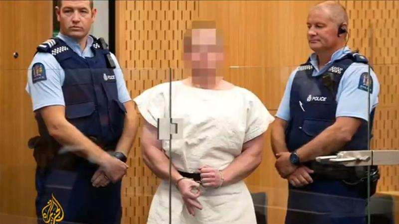 New Zealand mosque attack suspect Brenton Tarrant grins in court