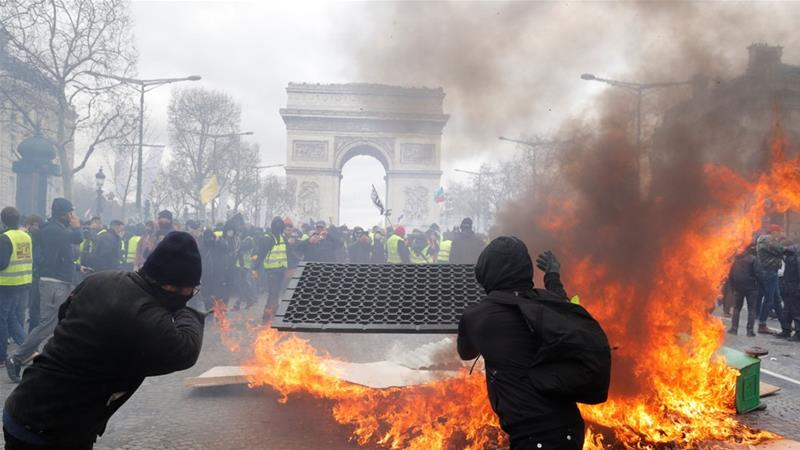 Police used tear gas and water cannons to repel protesters who gathered at the foot of the Arc de Triomphe [Philippe Wojazer/Reuters]