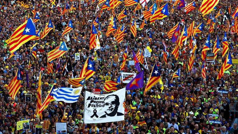 The protesters, many of whom made the journey from Catalonia, waved Catalan flags [Juan Medina/Reuters]