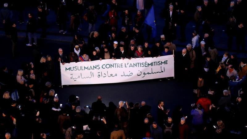 "People attend a national gathering to protest  the rise of anti-Semitic attacks in Paris, France, February 19, 2019. Banner reads ""Muslims against anti-Semitism"". [Philippe Wojazer/Reuters]"