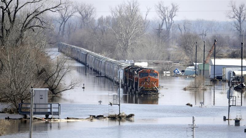 Heavy rain and warmer air are exacerbating flooding across six US states  [Nati Harnik/AP]