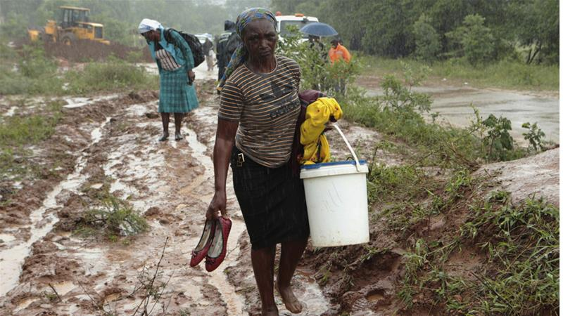 At least 15,000 have been displaced in Zimbabwe where poor weather conditions continue [Tsvangirayi Mukwazhi/AP]