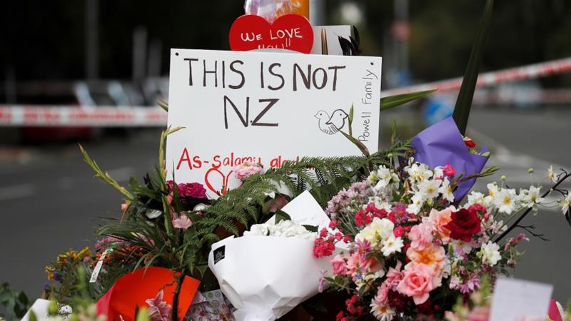 Flowers and signs are seen at a memorial as a tribute to victims of the mosque attacks, near a police line outside Al Noor mosque in Christchurch, New Zealand, March 16, 2019 [Jorge Silva/Reuters]
