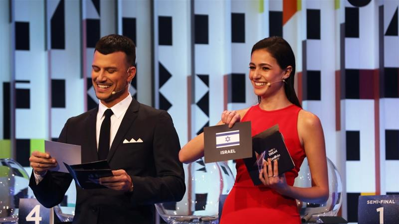 Presenters Assi Azar and Lucy Ayoub show the card of Israel during the Eurovision Semi-Final allocation draw, in the Tel Aviv Museum of Art, Israel on January 28, 2019 [Corinna Kern/Reuters]