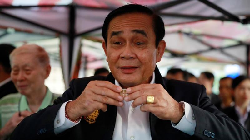 Thailand''s Prime Minister Prayut Chan-o-cha drinks tea with people who are exercising in Lumphini Park, ahead of the general election in Bangkok on March 20, 2019 [Reuters/Soe Zeya Tun]