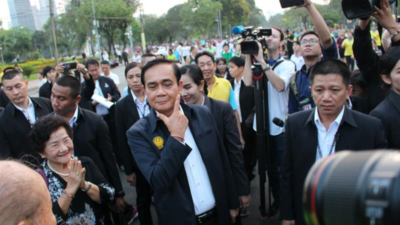 Smile and wiggle: Thai PM Prayuth tries to charm his way to a win