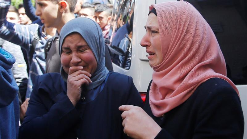 Women react after the Palestinian medic was killed by Israeli troops in Bethlehem [Mussa Qawasma/Reuters]