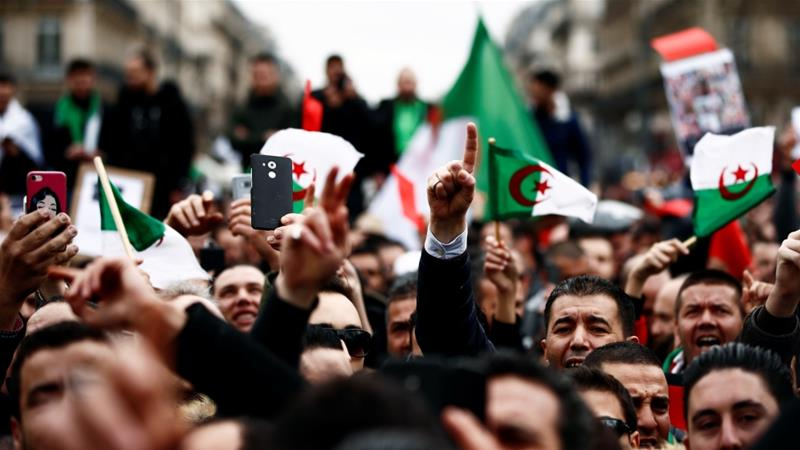 Demonstrators gather near the Monument to the Republic in Paris [Christian Hartmann/Reuters]