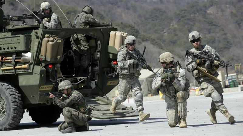 The joint war games will be reduced in order to ease tension with North Korea [File: Lee Jin-man/AP]