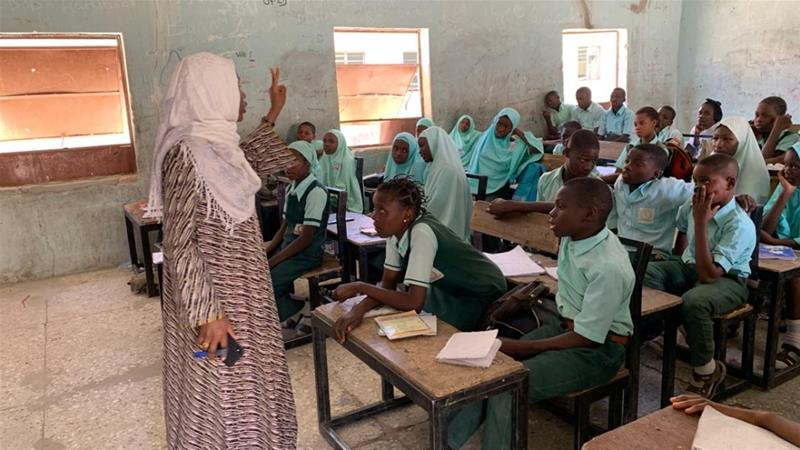 A member of the #ArewaMeToo movement discusses sex education with students in the northeastern city of Maiduguri [Hassana Maina/Al Jazeera]