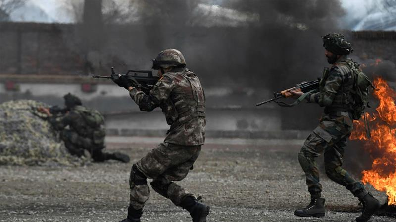 Chinese and Indian soldiers take part in the 'Hand in Hand' military exercise last year [An Yuan/CNS via Reuters]