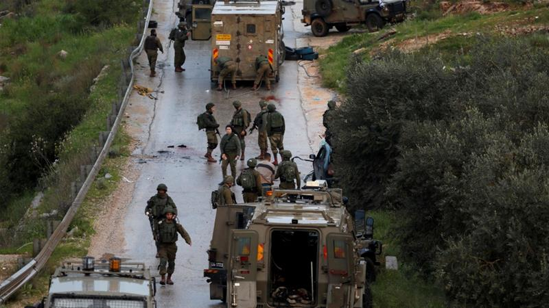 Israeli soldiers gather at the scene of an incident near Ramallah, in the Israeli-occupied West Bank [Mohamad Torokman/Reuters]