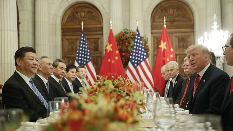 Trump and Chinese President Xi Jinping could seal a formal trade deal at a summit at the end of March, reports say [Pablo Martinez Monsivais/AP]