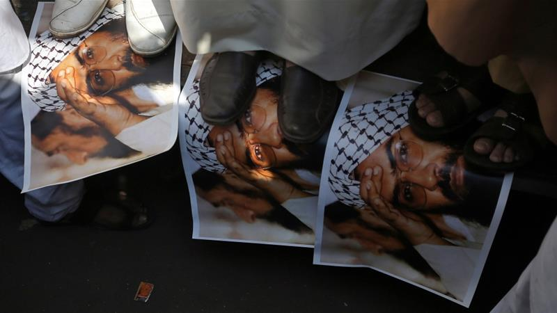 Indian protesters step on posters of Masood Azhar, head of the group Jaish-e-Muhammad, in February [Francis Mascarenhask/Reuters]