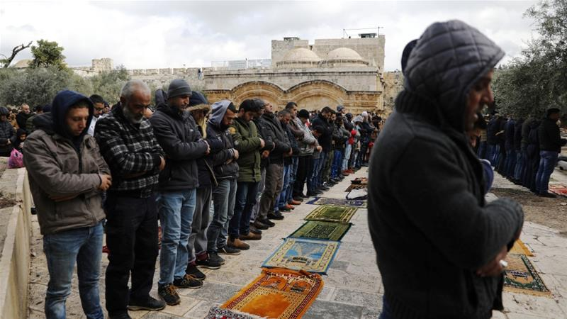 Palestinian Muslims attend Friday prayers outside the Golden Gate in the Al-Aqsa Mosque compound in East Jerusalem's Old City [Ammar Awad/Reuters]