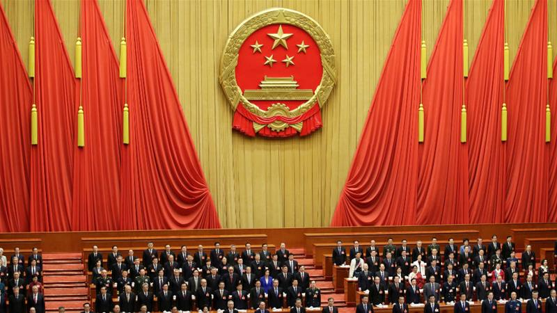 Officials sing the national anthem during the opening session of the National People's Congress at the Great Hall of the People in Beijing [Jason Lee/Reuters]