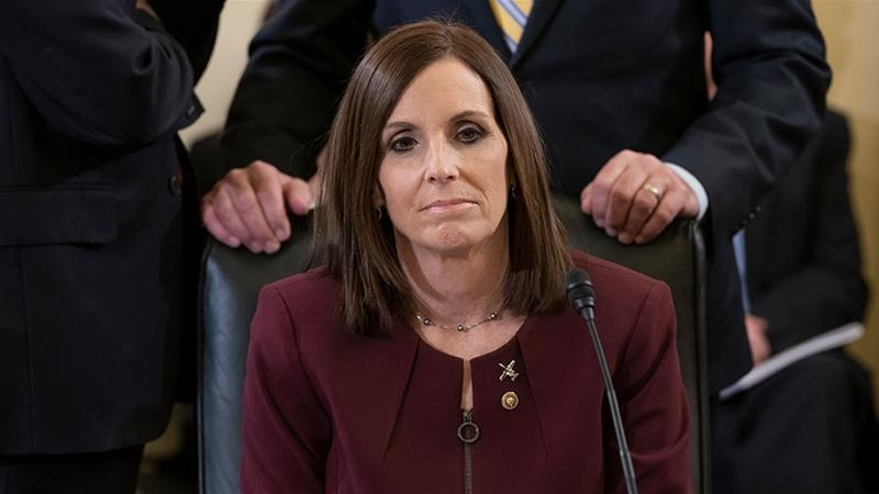 Senator Martha McSally prepares to recount her own experience while serving as a colonel in the Air Force [J Scott Applewhite/AP Photo]