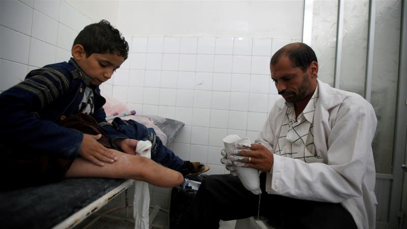 Yassir Abdulrahman, 10, who lost his leg in a Saudi-led air attack that hit near his family's home, has a checkup in Sanaa, Yemen [Khaled Abdullah/Reuters]