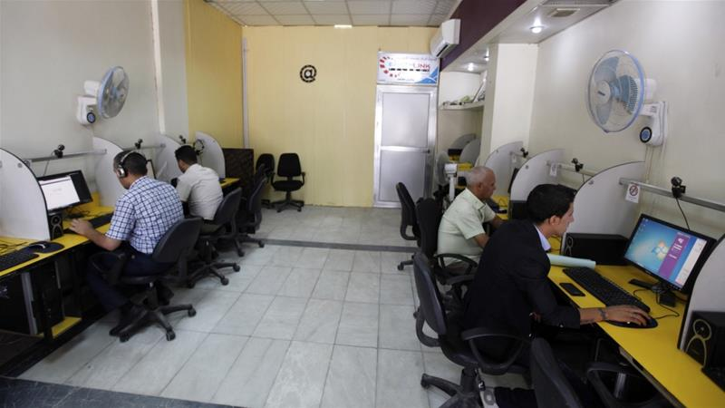 File: People surf the Internet at an Internet cafe in Baghdad, Iraq [File:Mohammed Ameen/Reuters]