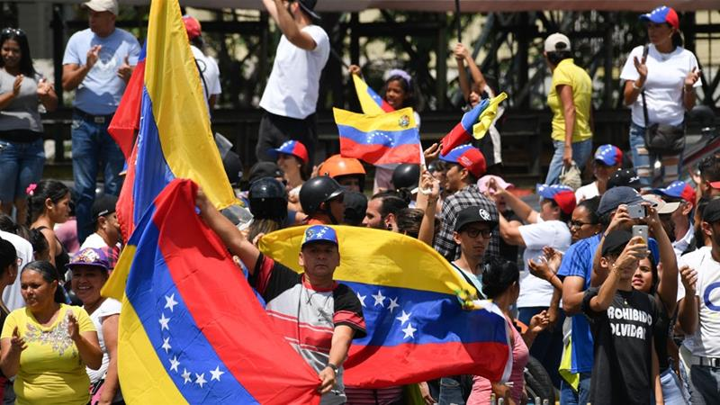 Supporters of Venezuelan opposition leader and self-proclaimed acting president Juan Guaido, demonstrate in Caracas on March 9, 2019 [File: Reuters]