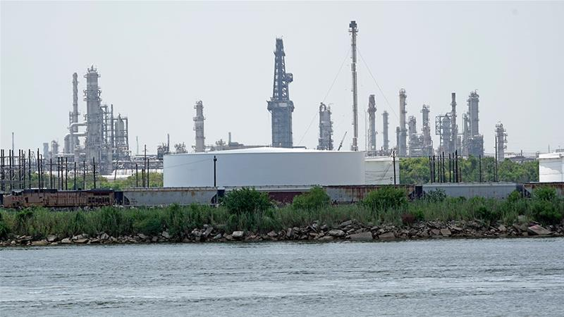Storage tanks at a refinery along the waterway are shown in Port Arthur, Texas [David J Phillip/AP Photo]