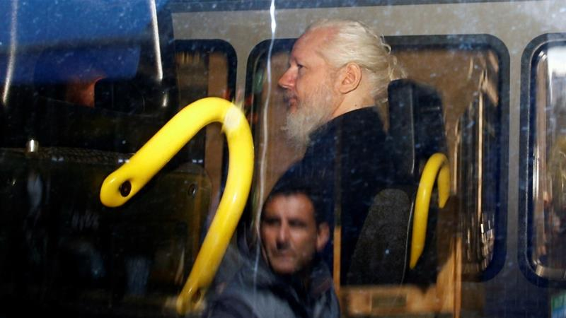 Assange is accused of violating bail in the UK and is wanted by US authorities [Henry Nicholls/Reuters]