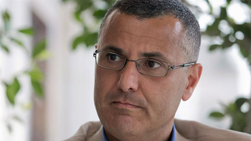 Omar Barghouti listens during an interview with the Associated Press in the West Bank city of Ramallah [File: Nasser Nasser/AP Photo]