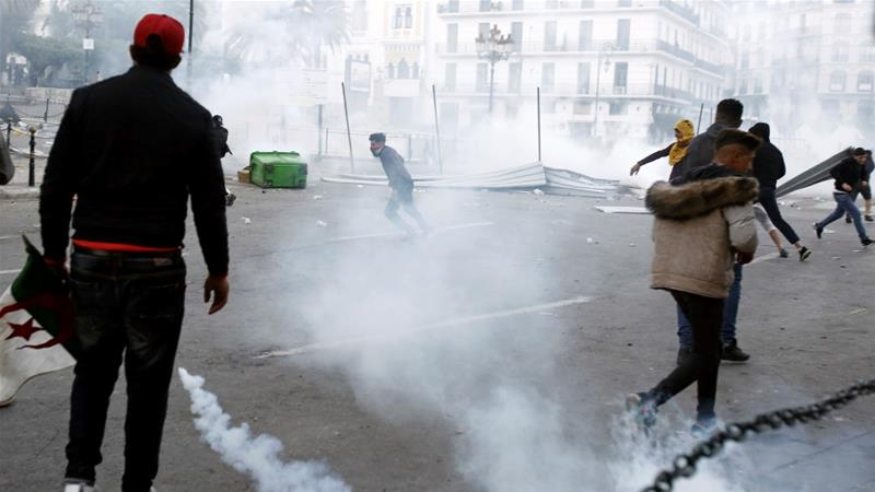 Police use tear gas, arrest scores of protesters in Algeria