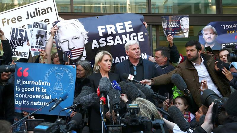 Kristinn Hrafnsson, editor-in-chief of WikiLeaks, and barrister Jennifer Robinson talk to the media outside the Westminster Magistrates Court after Assange was arrested [Hannah McKay/Reuters]
