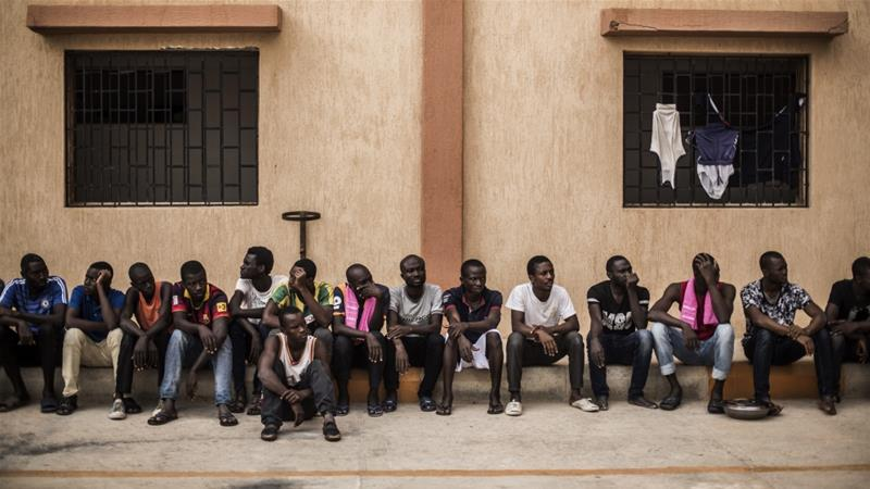Migrants wait in the courtyard of a detention centre in the village of Karareem, around 50km from Misrata, Libya. [File: Manu Brabo/AP]